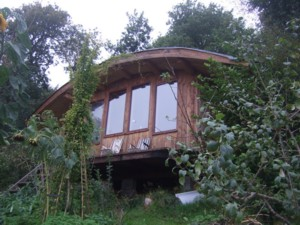 A cabin built on from green sitka spruce felled on site at Dunbeag, Argyll. Photo by Bob Mitchell