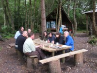 Some of the workshop participants sitting around the table in Wooplaw Comunity Woodland